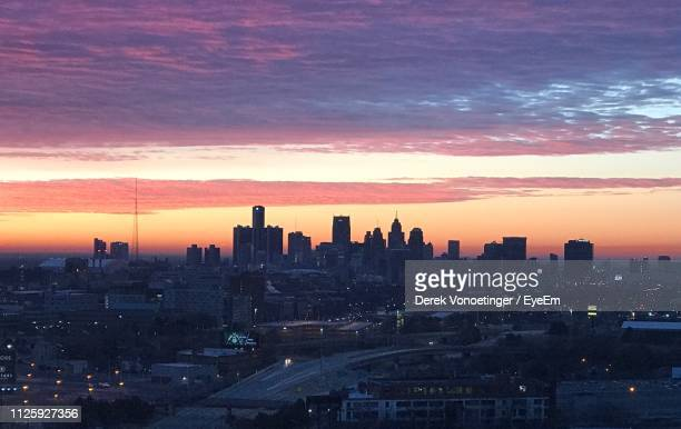 silhouette buildings against sky during sunset - デトロイト ストックフォトと画像