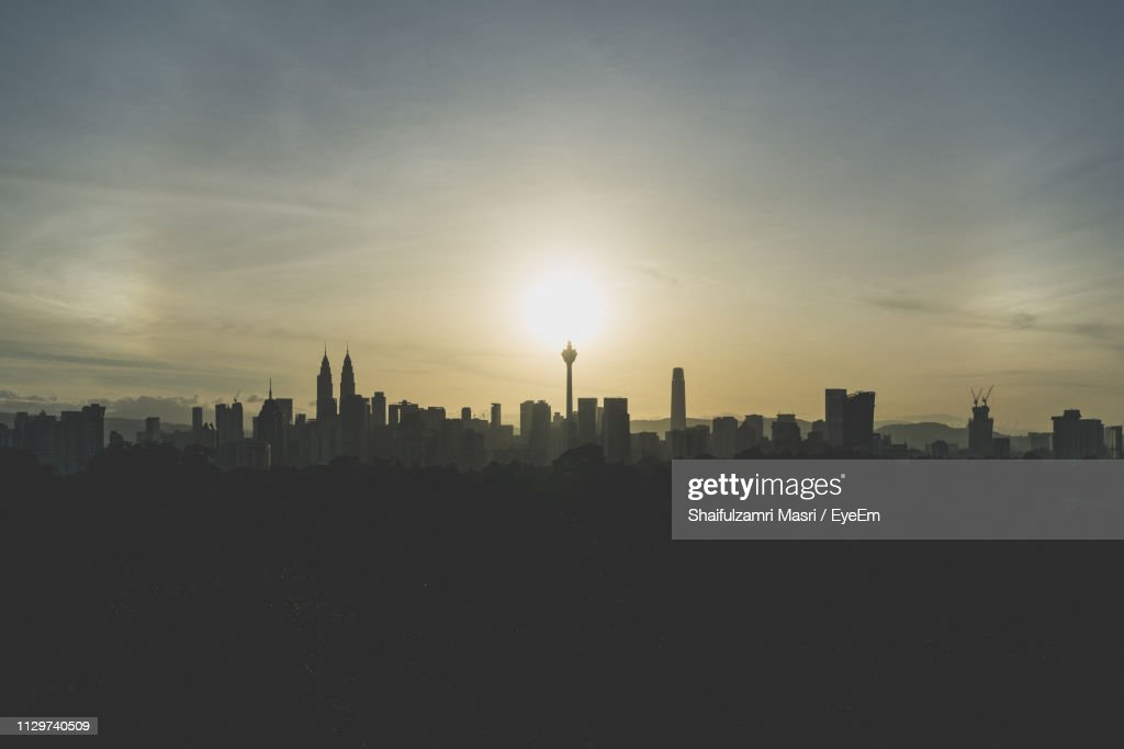 Silhouette Buildings Against Sky During Sunset : Stock Photo