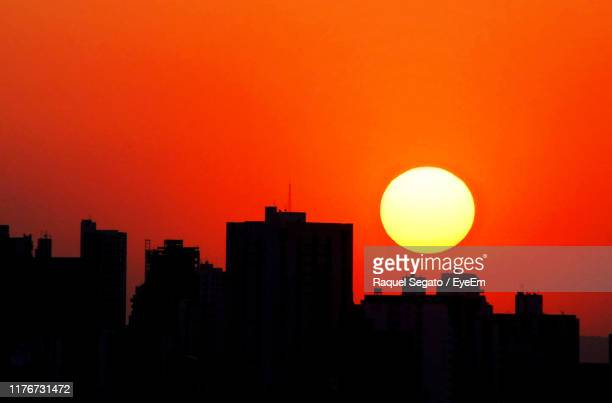 silhouette buildings against sky during sunset - goiania imagens e fotografias de stock