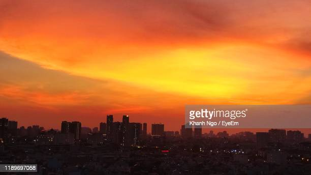 silhouette buildings against sky during sunset - khanh ngo stock pictures, royalty-free photos & images