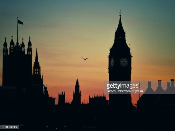 silhouette buildings in city during sunset - city of westminster london stock pictures, royalty-free photos & images