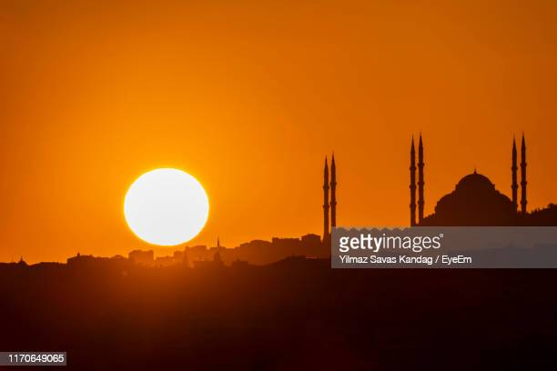 silhouette built structure against orange sky - turkey middle east stock pictures, royalty-free photos & images