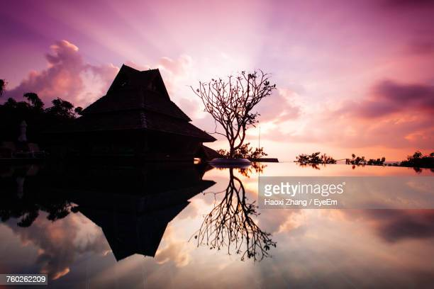 silhouette built structure against sky during sunset - surat thani province stock pictures, royalty-free photos & images