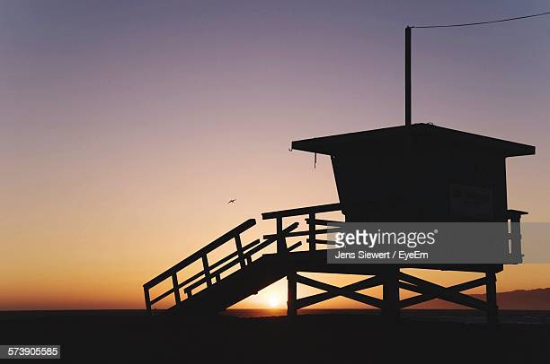 Silhouette Built Structure Against Sunset