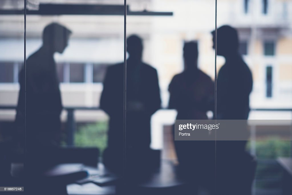 Silhouette business people discussing in meeting room : Stock Photo