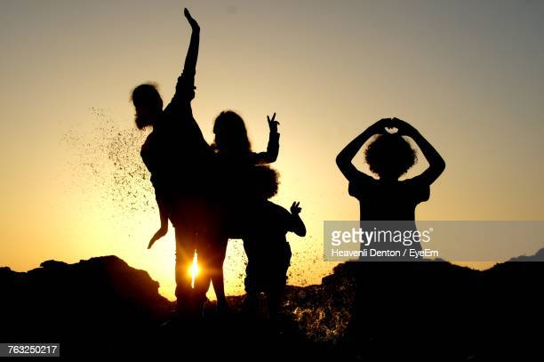 Silhouette Children Enjoying Against Clear Sky During Sunset