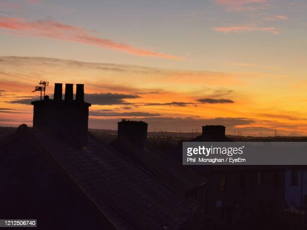 silhouette chimney against sky during sunset - sunset stock pictures, royalty-free photos & images