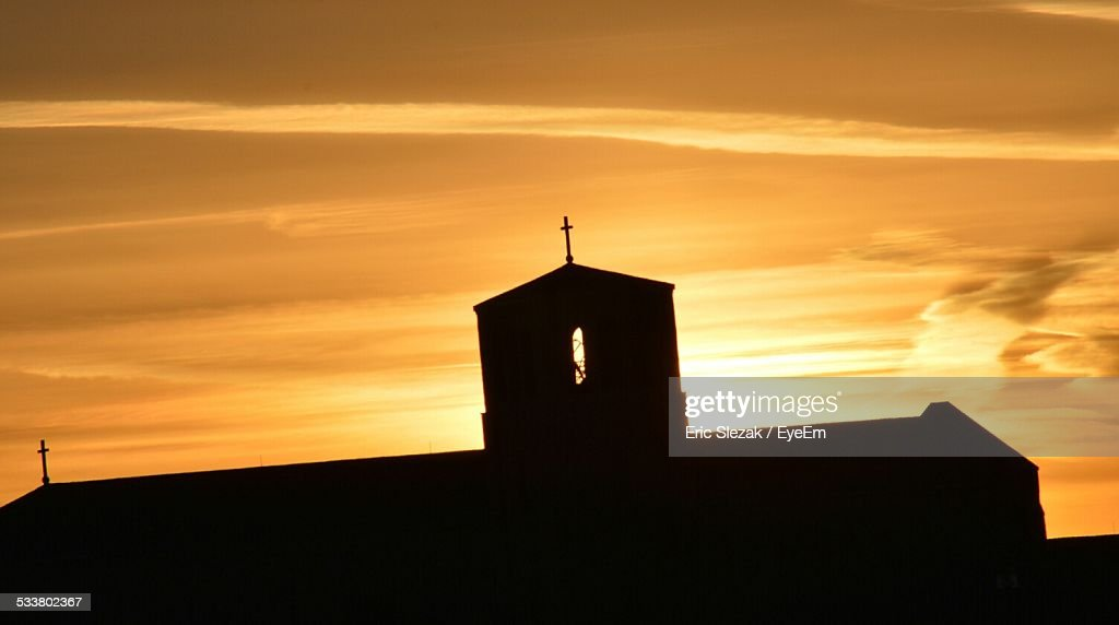Silhouette Church Against Orange Sky : Foto stock