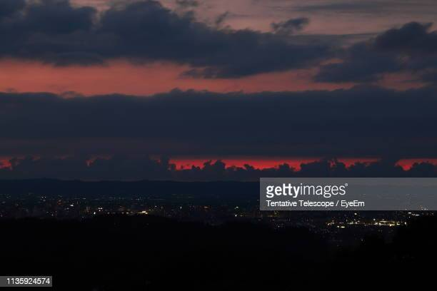Silhouette City Against Dramatic Sky During Sunset