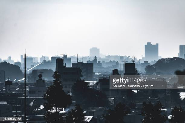 Silhouette Cityscape Against Clear Sky During Sunny Day