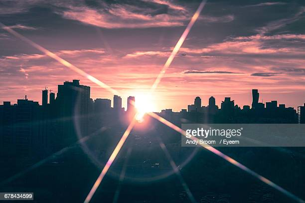 silhouette cityscape against sky during sunset - mississauga stock pictures, royalty-free photos & images