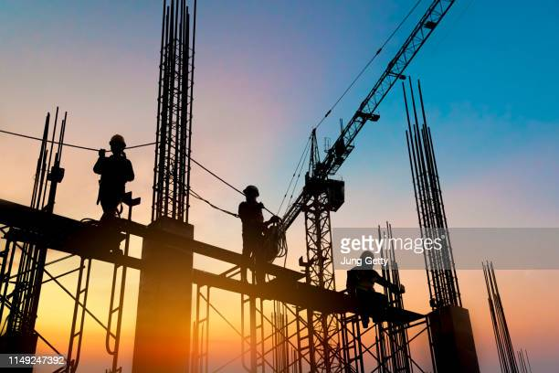 silhouette construction worker concrete pouring during commercial concreting floors of building in construction site and civil engineer inspection work - construction site stock pictures, royalty-free photos & images