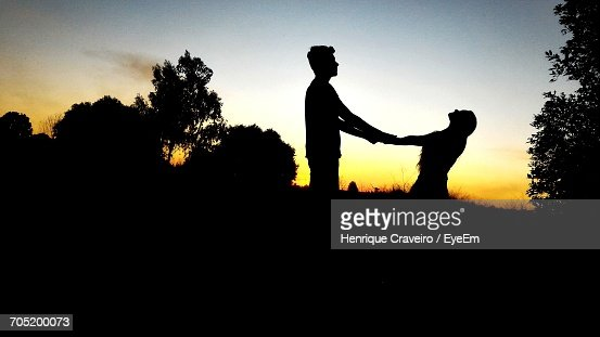silhouette couple holding hands on field against sky during sunset stock photo getty images