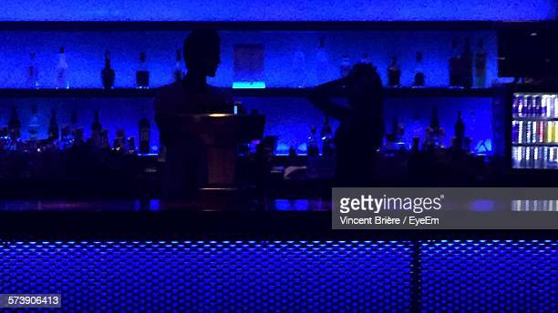Silhouette Couple Standing At Bar Counter