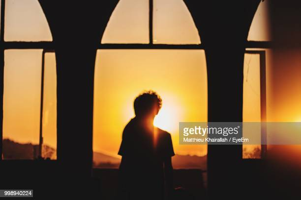 Silhouette Couple Standing In Corridor Against Romantic Sky At Sunset