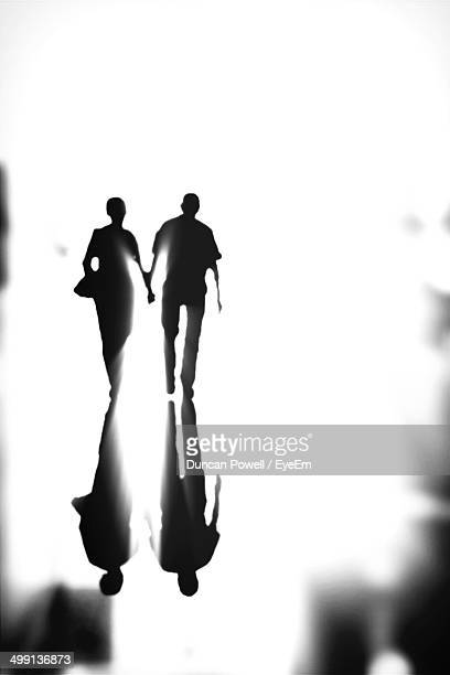 Silhouette couple walking outdoors