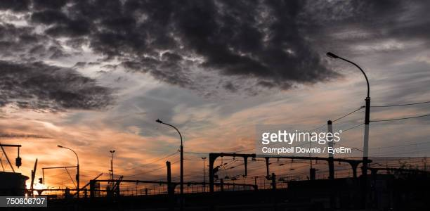 silhouette cranes against sky during sunset - campbell downie stock pictures, royalty-free photos & images