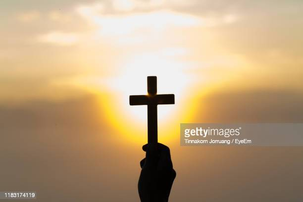 silhouette cross against sky during sunset - god stock pictures, royalty-free photos & images