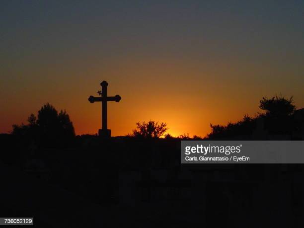 Silhouette Cross Against Sky During Sunset