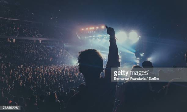 silhouette crowd enjoying during concert at night - music festival stock pictures, royalty-free photos & images