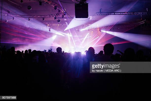 silhouette crowd facing stage at music festival - popular music concert stock pictures, royalty-free photos & images