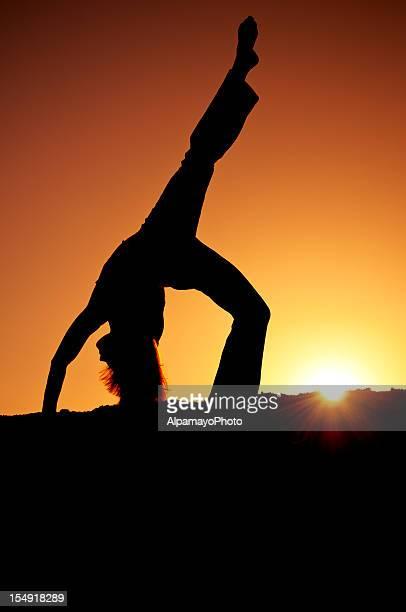 Silhouette doing yoga - III