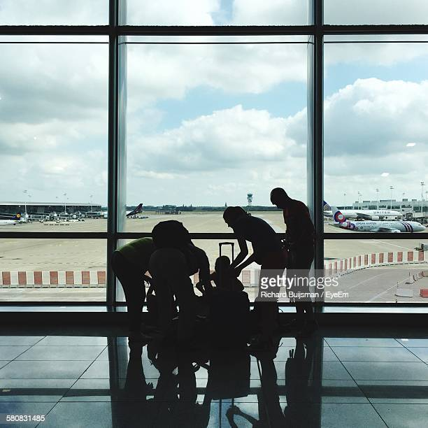 Silhouette Family At Airport Terminal