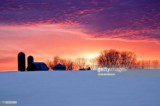 Silhouette farm sunset snow