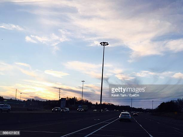 silhouette floodlight on highway during sunset - eyeem kevin tam stock pictures, royalty-free photos & images