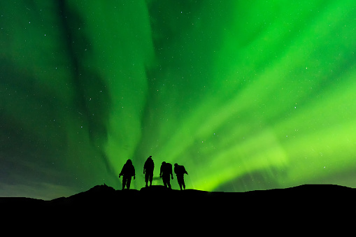 Silhouette group standing on top of peak mountain and Aurora light . - gettyimageskorea