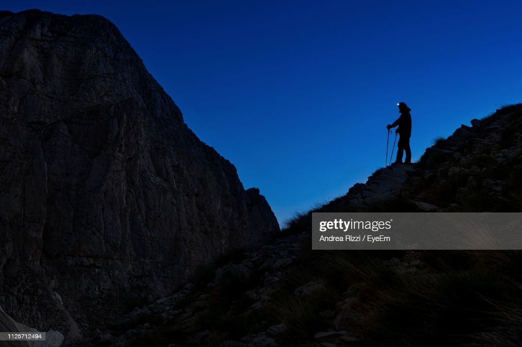 Silhouette Hiker Standing On Mountain Against Clear Sky : Foto stock