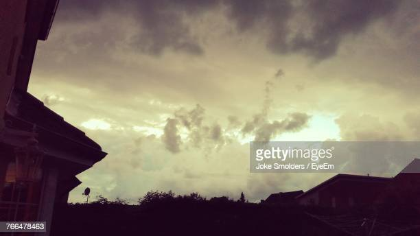 silhouette houses against sky during sunset - goch stock photos and pictures