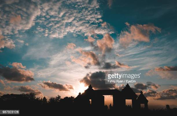 silhouette houses against sky during sunset - yogyakarta stock photos and pictures