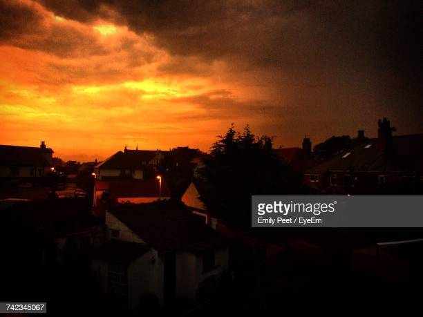 Silhouette Houses In Town Against Sky During Sunset