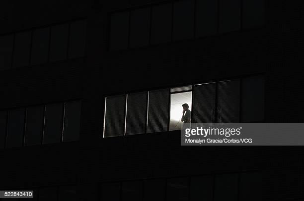 Silhouette In Office Window