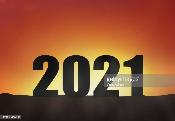 2021 silhouette in the sunset, new year holiday greeting card - 2010 stock pictures, royalty-free photos & images