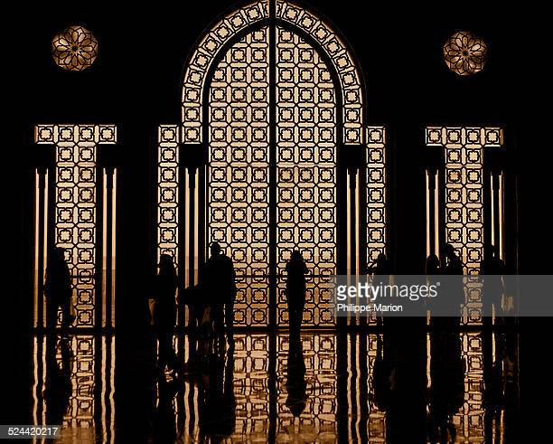 silhouette inside king hassan ii mosque, morocco - mosque hassan ii stock photos and pictures