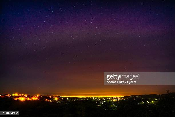 silhouette landscape against clear sky at night - andres ruffo stock-fotos und bilder