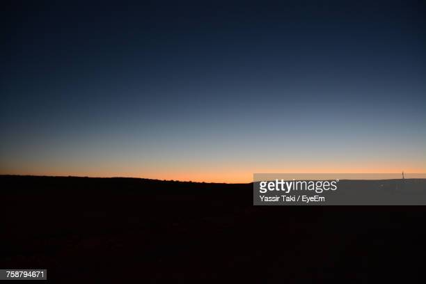 Silhouette Landscape Against Clear Sky