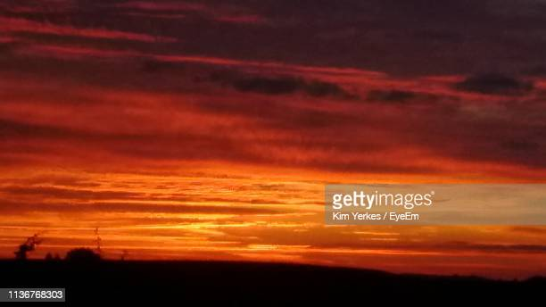 silhouette landscape against dramatic sky - kim ely stock pictures, royalty-free photos & images