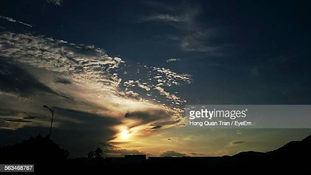 silhouette landscape against scenic sky - hong quan stock pictures, royalty-free photos & images