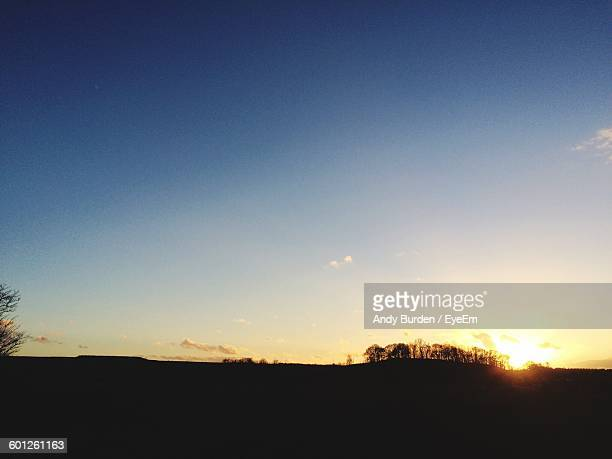 silhouette landscape against sky during sunset - malton stock pictures, royalty-free photos & images