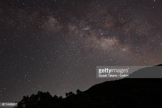Silhouette Landscape Against Starry Sky