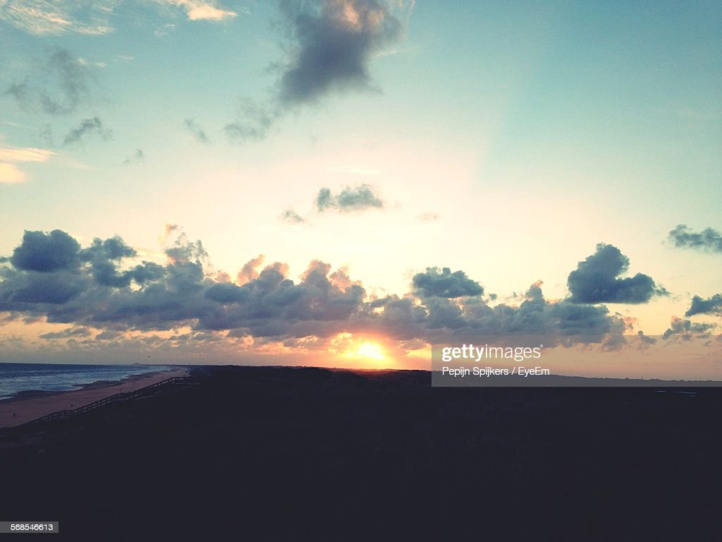 Silhouette Landscape By Beach During Sunset : Stock Photo
