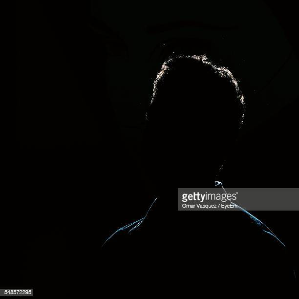 silhouette man against black background - back lit stock pictures, royalty-free photos & images