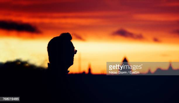 silhouette man against orange sky during sunset - niklas storm eyeem stock photos and pictures