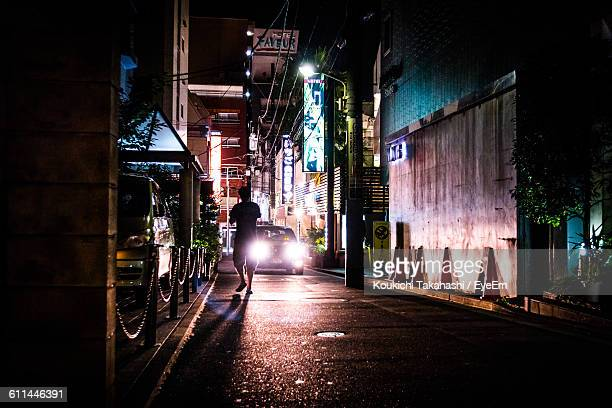 Silhouette Man And Car On Street At Night