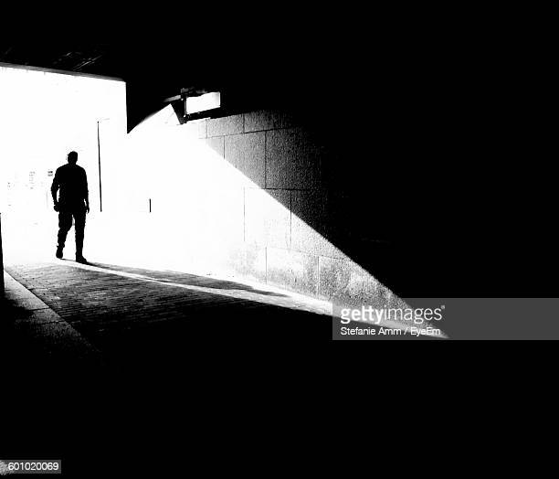 Silhouette Man Entering Tunnel
