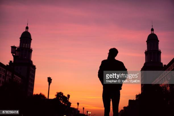 Silhouette Man Looking At Church Against Sky During Sunset