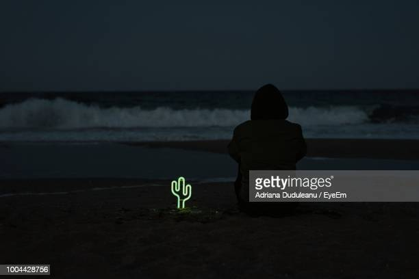 Silhouette Man On Sea Shore At Night